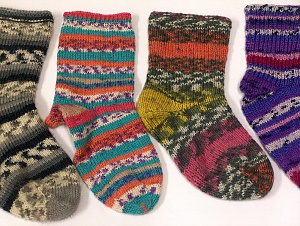 These are not pair of socks. They are knitted demos of sock yarn. Please be advised that this is not a yarn, but a pre-made item. Brand ICE, smp-833